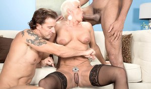 Mature Trinity Powers goes wild at the office by fucking anal with two males