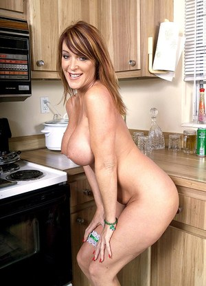 BBW mature slut Rachel Steele undresses in the kitchen to rub her gaping pussy