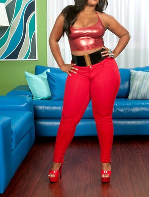 Chubby ebony hottie Gizelle Stallion takes off her red pants to toy her cunt