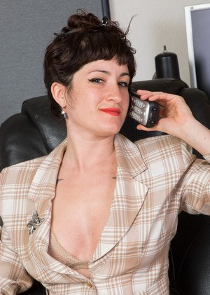 Mature office lady Stacey Stax takes off her clothes to show off a hairy twat