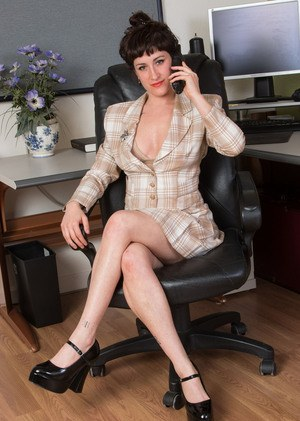 Kinky office slut Stacey Stax strips in the office to boast of her hairy pussy