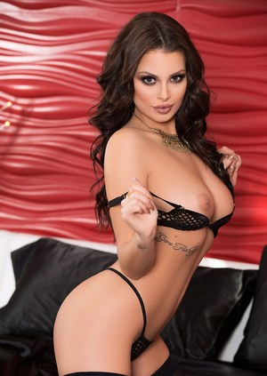 Hot brunette Shelly Lee models in sexy black stockings for centerfold spread