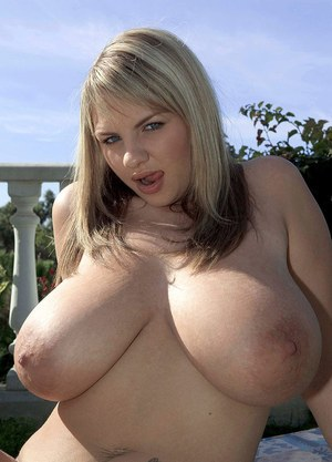 Euro model Kelly Kay releases her massive boobs from bikini top in backyard