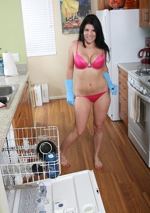 Dark haired housewife Erin Marxxx undresses for nude poses in latex gloves