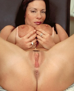 Buxom European hottie Linsey Dawn McKenzie plays with her jugs and shows pussy