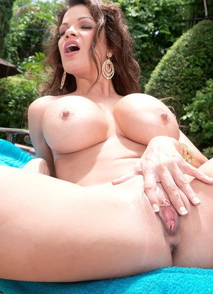 Tight hottie with big fake boobs Jaded Dawn finger fucks her pussy near a pool