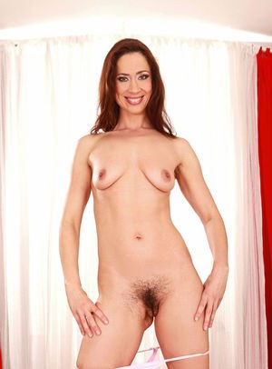Glamour redhead Pepper spreads her thighs to reveal her tiny hairy pussy hole