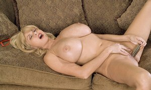 Busty mature Penny Porsche works pussy and ass with a very stiff toy cock