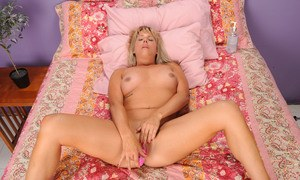 Slutty mature Kayla Larson works toys down her greedy cunt for a whole solo