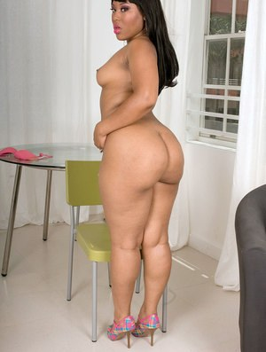 Chubby older black lady Luscious Louis vaunts her big booty while getting nude