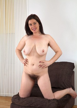 Chubby mature woman Janey shows off her awesome hairy pussy and big saggy tits