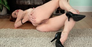 Older lady Betty Blaze undresses and masturbates her smooth pussy