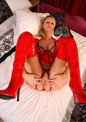 Sexy MILF Jessica creams her bald pussy while taking off her latex clothing