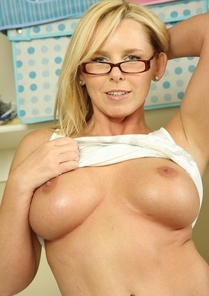 Mature in glasses Lacey Love strips off in the kitchen exposing tits and cunt