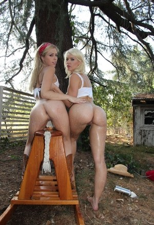 Candy ass lesbian girlfriends take off shorts to pose naked outdoors
