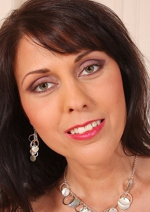 Gorgeous mature stunner Anita poses in high heels showing her glorious pussy