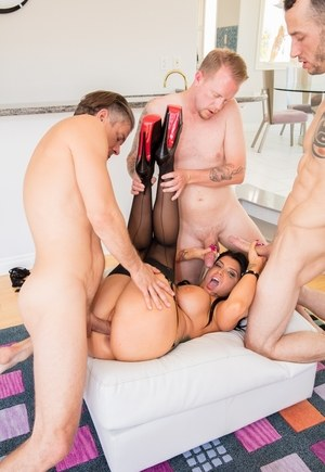 Shameless porn model in black stockings Romi Rain deals with many cocks