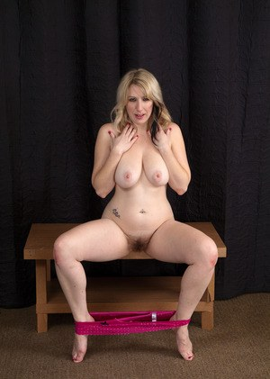 Chubby aged woman with saggy boobs Mel Harper stretches her hairy beaver