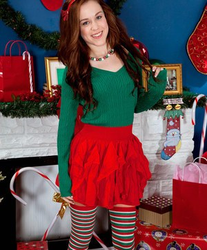Redhead teen Trinity Rae shows off her shaved twat in thigh high socks at Xmas