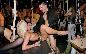 Drunk chicks dance away at a club before initiating an orgy on dance floor