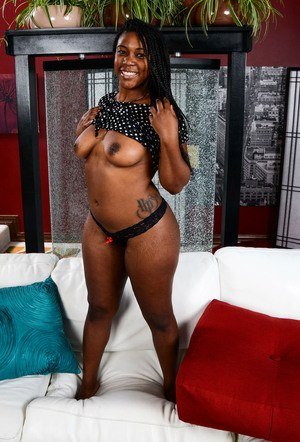 Exotic amateur stunner Janelle Taylor shows off her black body and pink snatch