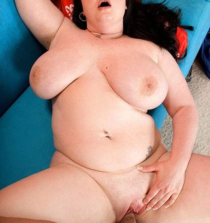 Overweight female Monique L'Amour entices a man with her huge boobs