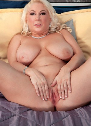 Older solo model Morgan Page showcases her shaved cunt after lingerie removal