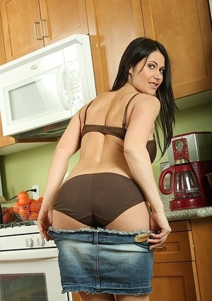 European mother Eva Karera bare her large boobs while undressing in kitchen