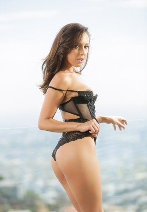Hot Latina Jenna Sativa peels off her sensual black lingerie on a rooftop