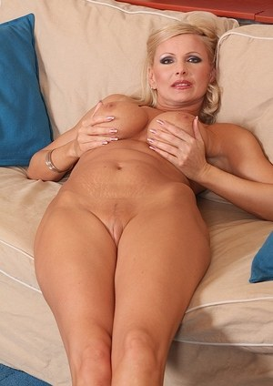 Sexy older blonde fingers her pink vagina after getting out of her tight dress