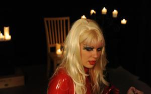 Hot blonde domme uses her female slave wearing red latex outfit