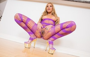 Latina pornstar Chloe Amour sets her firm tits free from sexy bodystocking