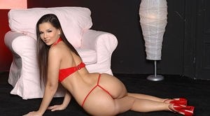European MILF Eve Angel plays with her pussy wearing revealing red lingerie