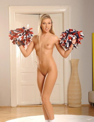 Cute cheerleader Cherry Jul unveils her bald pussy with pompoms in hand
