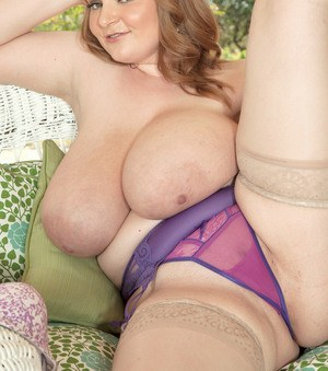 BBW MILF Micky Bells gets out of her tight skirt on her way to posing topless