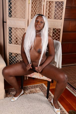 Curvy ebony amateur Osa peels off her clothing one piece at a time