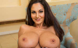 Brunette cougar Ava Addams reveals her round boobs while getting undressed