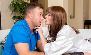 Horny cougar Krissy Lynn puts the moves on a younger boy in black stockings