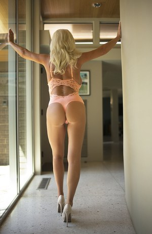 Hot older housewife Sandra Otterson finds her hooters spilling out of onesie