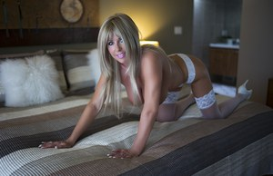 Hot older housewife Sandra Otterson strips down to white stockings on her bed