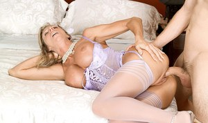 Cheating blonde wife Delilah greets her younger lover in sexy lingerie