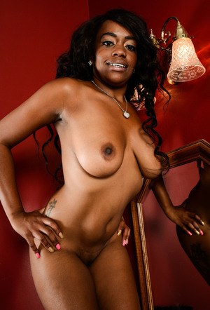 Black amateur Amber Cream slips off bra and panty set to model in the nude