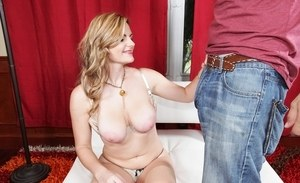 Topless blonde chick Keiyra Lina holds her big natural tits while giving a BJ