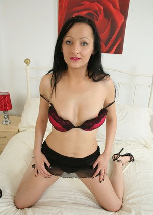 Older woman Mimi peels off her sexy lingerie to expose her pink pussy