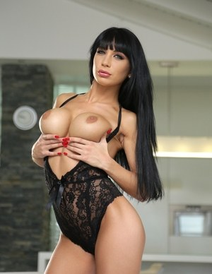 Raven haired solo model Valentina Ricci releases her fake tits from lingerie