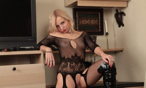 Sexy mature blonde in black boots takes off her fetish oriented clothing