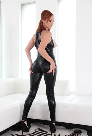 Redhead Audrey Hollander and a blonde model assless leather wear together