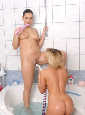Younger and older MILFs Kathia Nobili & Eve Angel play games with toys in bath