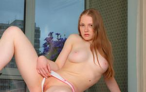 Beautiful redhead teen Nerila displays her nice tits and hairless vagina