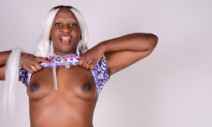 Black female Osa tries her hand at modelling in the nude for the first time